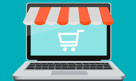 Showcase Online Store. On a laptop and cart. Vector illustration Stock Images