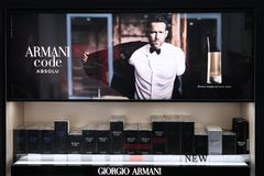 Showcase perfume for men Code Giorgio Armani advertising company with Ryan Reynolds. Moscow. 20.03.2019 stock image