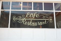 Showcase of a restaurant cafe written on the window as in 1900. Retro showcase of a restaurant cafe written on the window as in 1900 stock photo