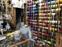 Showcase sewing shop with lots of ribbons and ruffles royalty free stock photos