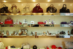 Showcase with shoes and bags. Royalty Free Stock Images
