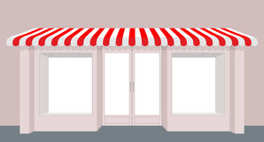 Showcase shop. Rose Shop building. Striped awning store. Facade Stock Photo