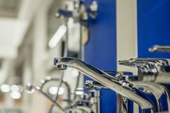 Showcase in the store with faucets for the kitchen and bathroom.  royalty free stock photo