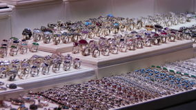 Showcase Store Jeweler Ornaments. Silver rings with precious stones, necklaces on mannequins and various ornaments. Shops with Asian Goods on Soho Square stock footage