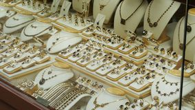 Showcase Store Jewelry Ornaments. Silver and Gold rings with precious stones, necklaces on mannequins and various ornaments. Shops with Goods in Prague, Czech stock footage