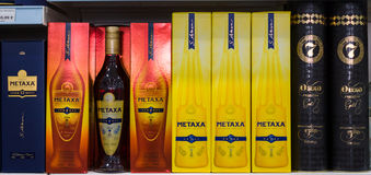 Showcase with traditional Greek alcoholic beverages Ouzo and Metaxa Royalty Free Stock Photos