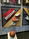 Showcase window of Nike store at Istiklal street with Air Jordan sneakers and basketball ball and shorts stock image