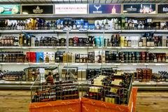 Showcases the alcohol in the duty free shop on the ferry Tallink Royalty Free Stock Image
