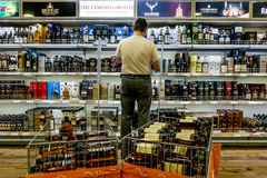 Showcases the alcohol in the duty free shop on the ferry Tallink Royalty Free Stock Photos