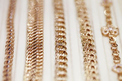 Showcases, gold, chain, close-up royalty free stock photos