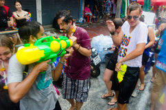 Showdown. Bangkok, Thailand, 13 April 2015. A pair of tourists face each other in a water gun battle at Khao San Road. The annual Songkran water festival is Royalty Free Stock Image