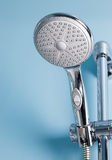 Shower. On the blue wall Royalty Free Stock Image