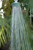 Shower. Taking a shower under the palms Royalty Free Stock Photography
