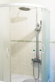 Shower in the bathroom Stock Image