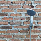 Shower on a brick wall Royalty Free Stock Photo
