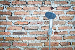 Shower on a brick wall Royalty Free Stock Photos