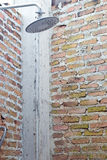 Shower on a brick wall Royalty Free Stock Images