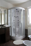 Shower cabin. Modern shower cabin in a hotel bathroom stock photo
