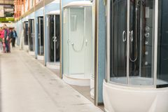 Shower cabins in the sanitary ware shop. inside HomePro store. The store provide advice and facilities for installation Stock Images