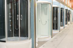 Shower cabins in the sanitary ware shop. inside HomePro store. The store provide advice and facilities for installation and mainte stock photography