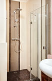 Shower-cubicle in beige tones Royalty Free Stock Photography