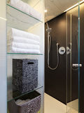 Shower cubicle in the modern bathroom. With  glass shelves Stock Photo
