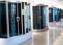 Shower cubicles in store Royalty Free Stock Images
