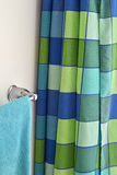 Shower curtain and towel rack Royalty Free Stock Photography