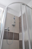 Shower enclosure, new bathroom. Shower enclosure made of plastic and glass, home interior royalty free stock image