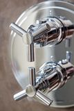 Shower equipment on wall. Hand shower equipment on brown wall of bathroom Royalty Free Stock Photo