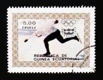 Shower för Ekvatorialguinea portostämpel rusar att åka skridskor, olympiska spel i Innsbruck, circa 1976 Arkivbilder