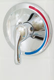 Shower faucet. Cold and hot water in the bathroom Stock Images