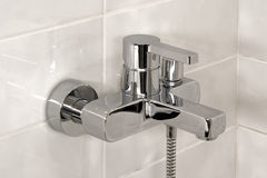 Shower faucet. New shining bright modern shower faucet Royalty Free Stock Photography