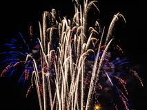 Shower of Fireworks Spraying Upwards. Royalty Free Stock Image