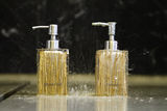 Shower gel and shampoo bottles Stock Image