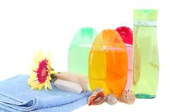 Shower gel, shampoo and towel, isolated. Royalty Free Stock Photos