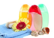 Shower gel, shampoo and towel, is isolated. Royalty Free Stock Photos
