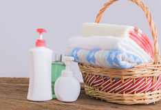 Shower gel with Skin cream and bath towels in basket Royalty Free Stock Photo