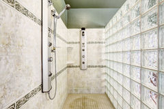 Shower with glass block wall and tile trim Royalty Free Stock Photos