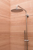 Shower Head. With water flow on a marble background royalty free stock photography
