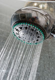 Shower head. With floating water in a bathroom royalty free stock photography