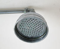 Shower Head. This photo shows a close-up of an old shower head found in a 300+ year old house, complete with lime scale Royalty Free Stock Photography