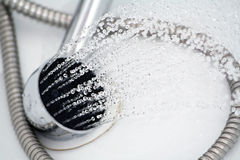 Shower head. And running water in the bathroom Royalty Free Stock Photography