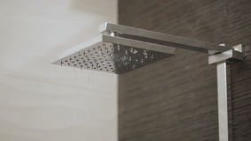 Shower head in bathroom dripping stock video footage