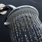 Shower head in bathroom with water drops Stock Photography