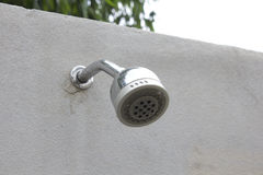 Shower head  the cement walls Stock Photo