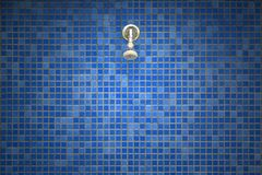 Shower head on tiles mosaic background. Shower head on ceramic blue colored tiles mosaic background royalty free stock photos
