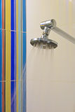 Shower Head with Colorful Background Tiles Royalty Free Stock Image