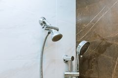 Modern shower head in bathroom with new home construction. Shower head in modern bathroom with new home construction, handshower, household, showering, plumbing stock photo