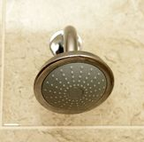 Shower head. A new wide shower head installed in the bathroom royalty free stock photo